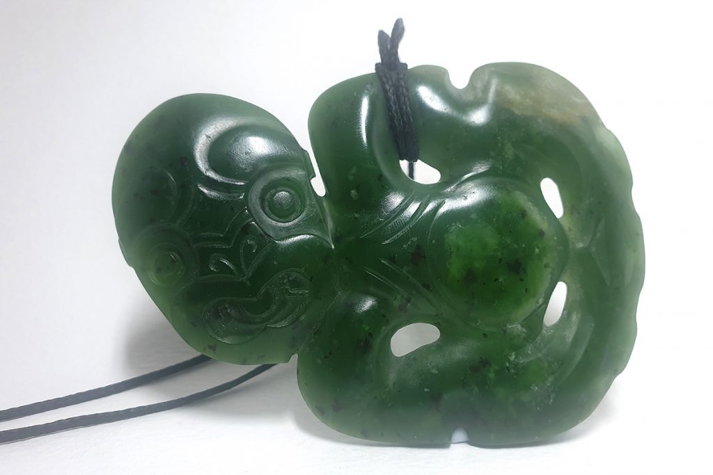 Greenstone tiki pendant by Al Brown