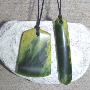 Greenstone pendants carved by Al Brown