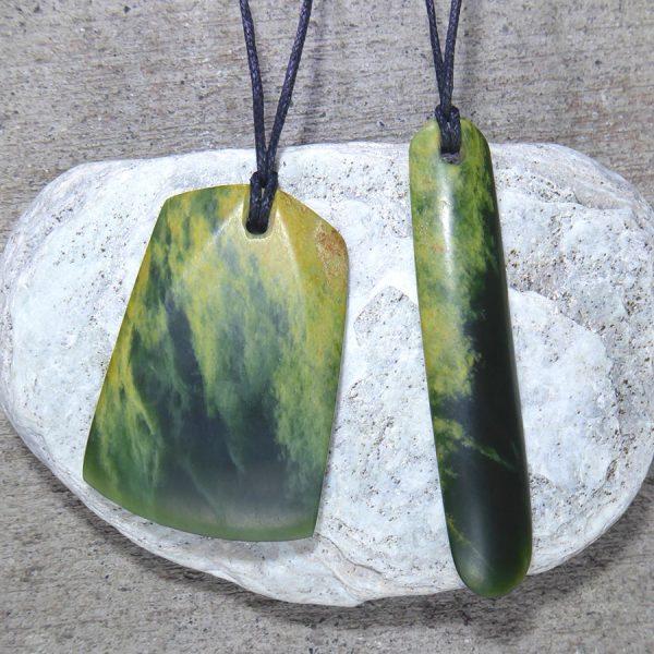 Greenstone pendants carved by Al Brown
