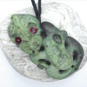 Carved greenstone hei tiki pendant by Alex Sands from Kura Gallery