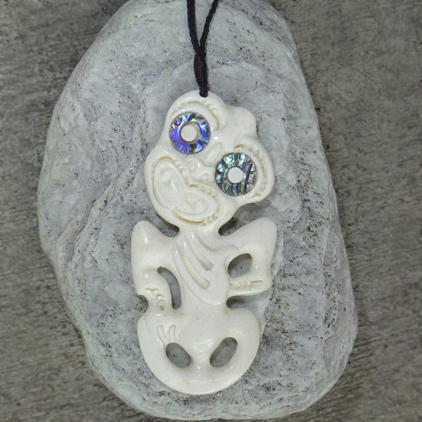 Tiki pendant carved from whalebone with paua eyes by Alex Sands