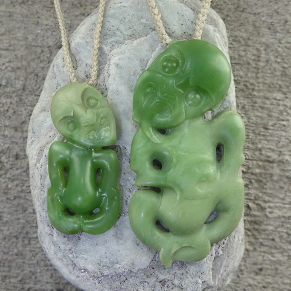 Two NZ greenstone tiki pendants by Andrew McGregor