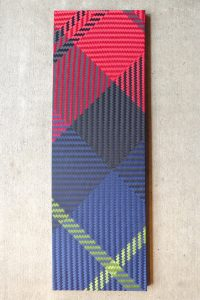 Wall panel of woven ribbon in tartan pattern from Kura Gallery, by Annabelle Buick