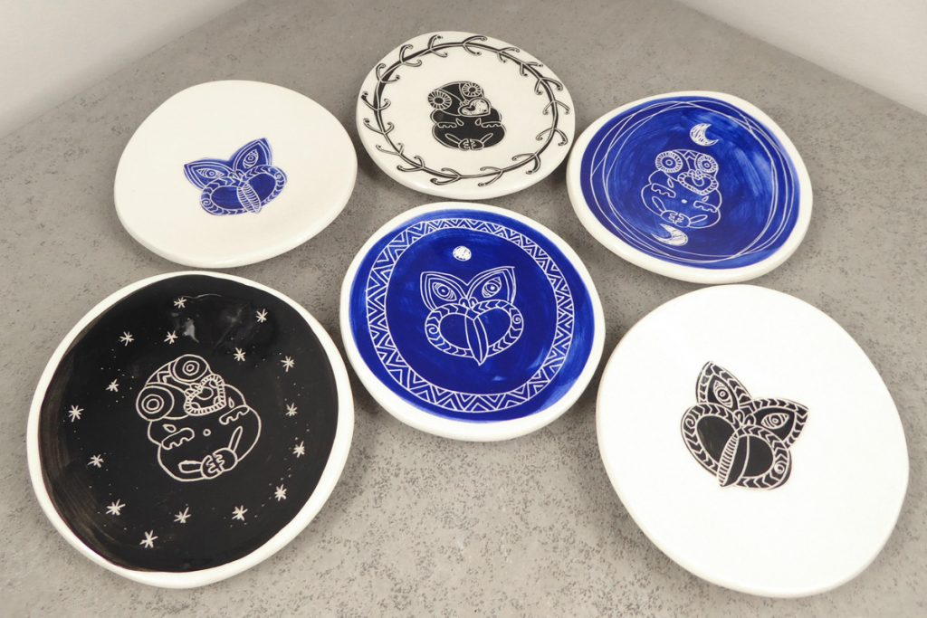 Small ceramic dishes with tiki design, by Borrowed Earth