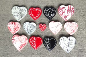 Ceramic red, black and white hearts by Borrowed Earth from Kura Gallery