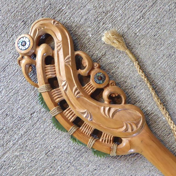 Traditional maori wood-carved maripi or cutting knife by Bronson Baker from Kura Gallery