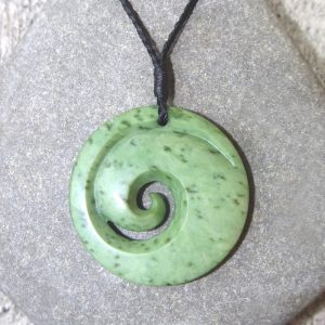 NZ greenstone koru, or spiral, pendant by Clarence Collier