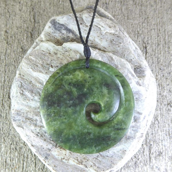 Greenstone koru pendant by Clarence Collier