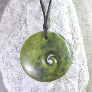 NZ greenstone koru or spiral pendant by Clarence Collier