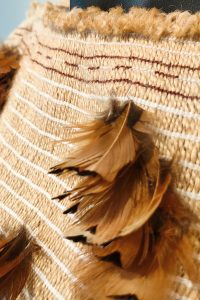 Woven maori cloak with pheasant feathers by Gary Grace