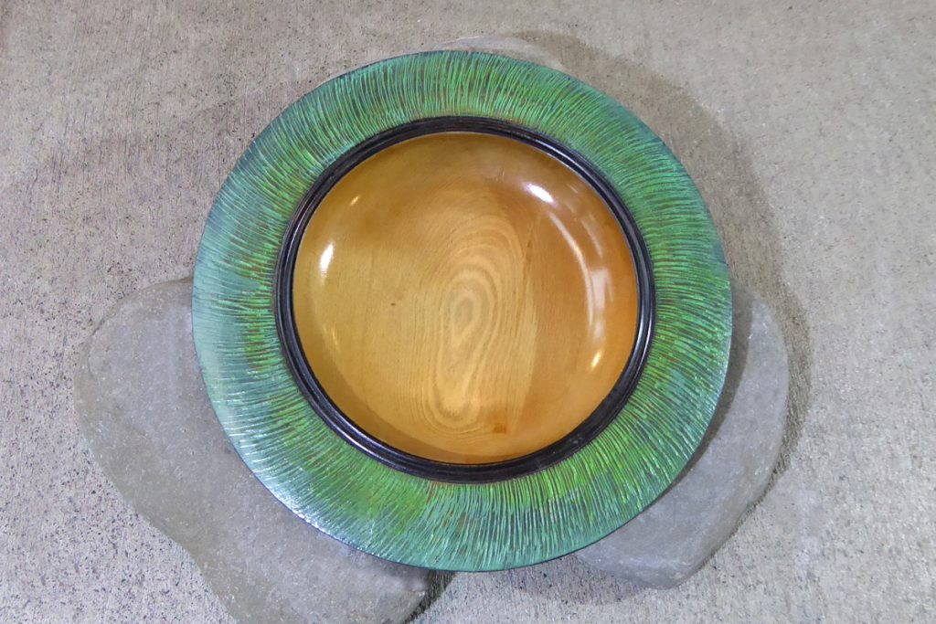 Bowl carved from NZ rimu with green edge by Hugh Mill