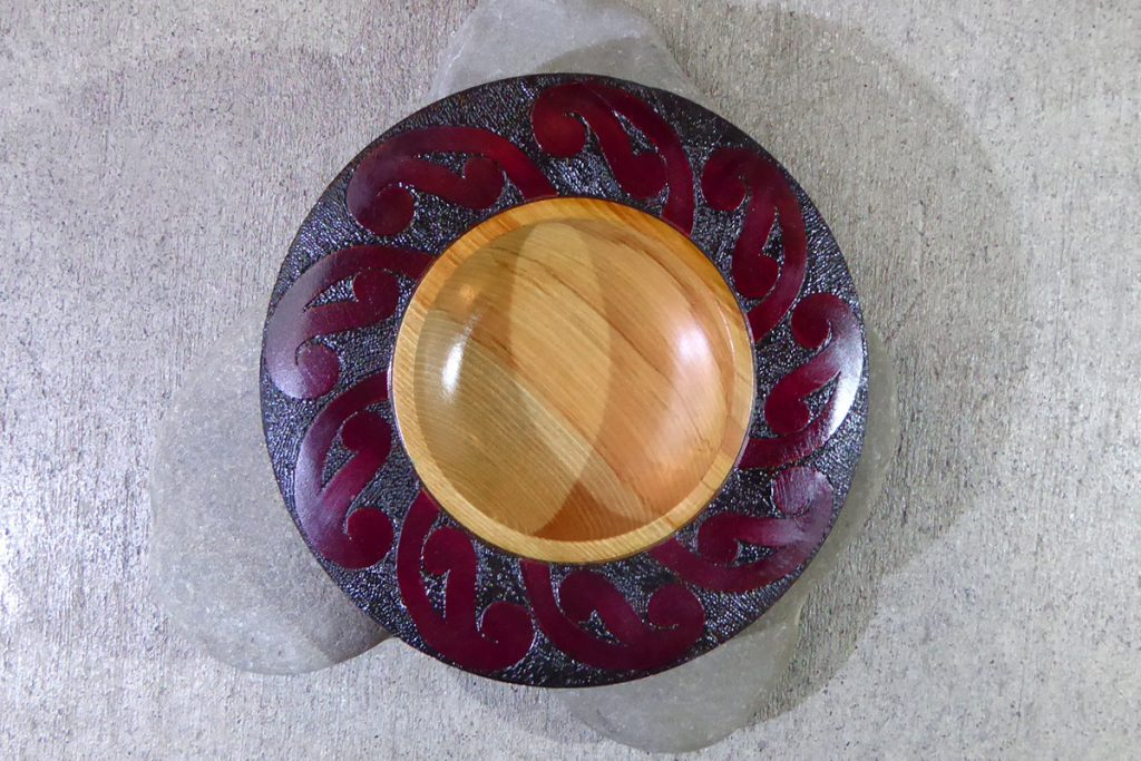 NZ rimu carved bowl with red edge by Hugh Mill