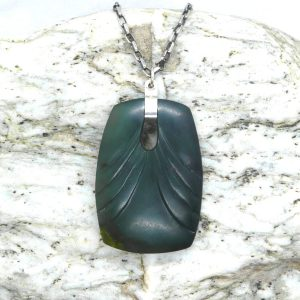 Greenstone art deco adze pendant by Josey Coyle from Kura Gallery