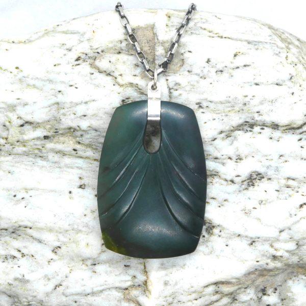 Greenstone art deco adze pendant by Josey Coyle from Kura Gallery