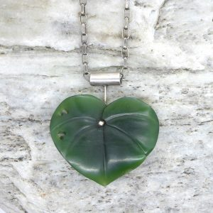 Carved greenstone kawakawa leaf by Josey Coyle from Kura Gallery