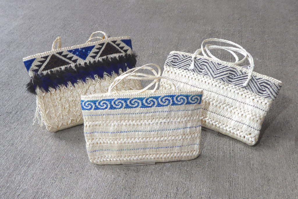 Woven flax kete, or baskets, by Jude Te Punga Nelson