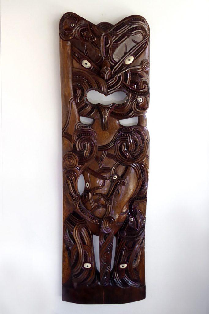 Carved wooden Poupou (part of a maori house) by Hohepa Peni