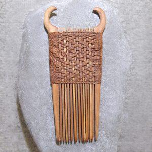 Traditional maori wooden heru or comb, by Layton Robertson