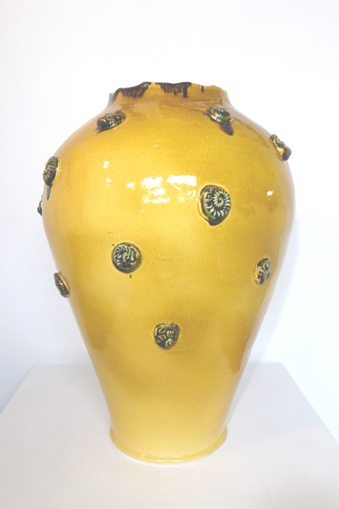 Clay pot with yellow amber glaze by Maria Brockhill