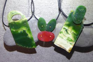 Contemporary carved greenstone tikis by Neil Adcock