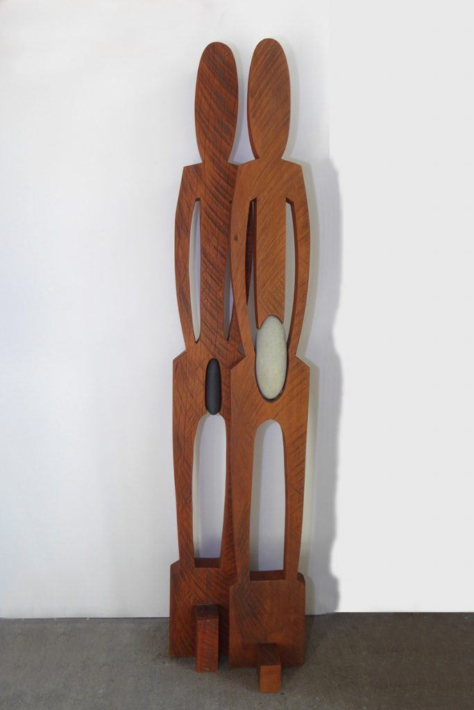 Carved wooden sculpture of male & female forms called 'Man & Woman' by Peter Radley