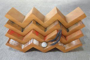 Wooden sculpture called 'Tukutuku' by Peter Radley