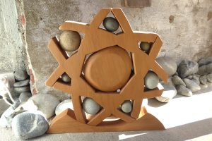 Wood & stone sculpture called 'Wheel of Life' by Peter Radley
