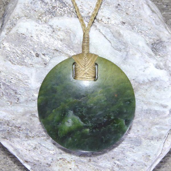 Greenstone circular kopae pendant by Raegan Bregmen