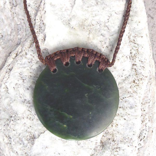 Greenstone kopae or disc pendant by Raegan Bregmen