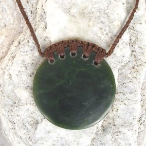 Greenstone kopae or disc pendant by Raegan Bregmen