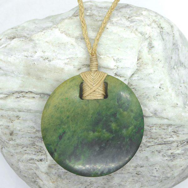 Greenstone disc pendant by Raegan Bregmen from Kura Gallery