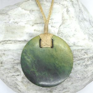 Greenstone disc pendant by Raegan Bregmen from Kura Gallery
