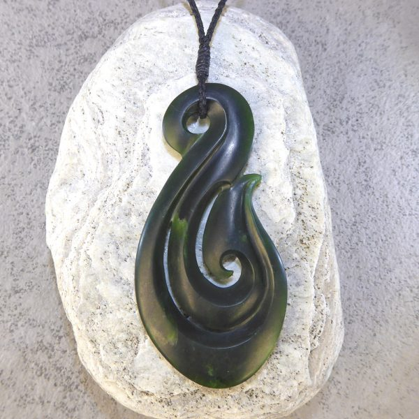 NZ greenstone matau or fish hook pendant by Raegan Bregmen