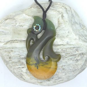 Greenstone manaia matau pendant by Scott Parker from Kura Gallery