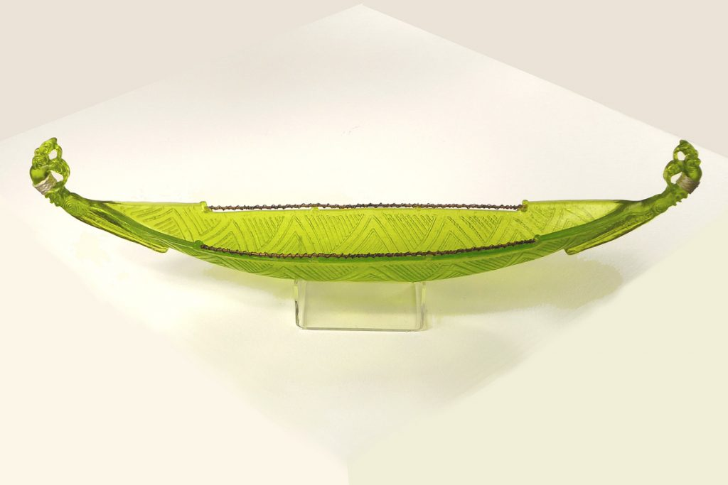 Green glass waka or canoe by Shona Firman