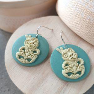 Circular resin earrings with tiki by Tania Tupu