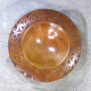 Wooden bowl with carved maori design by Thomas Hansen