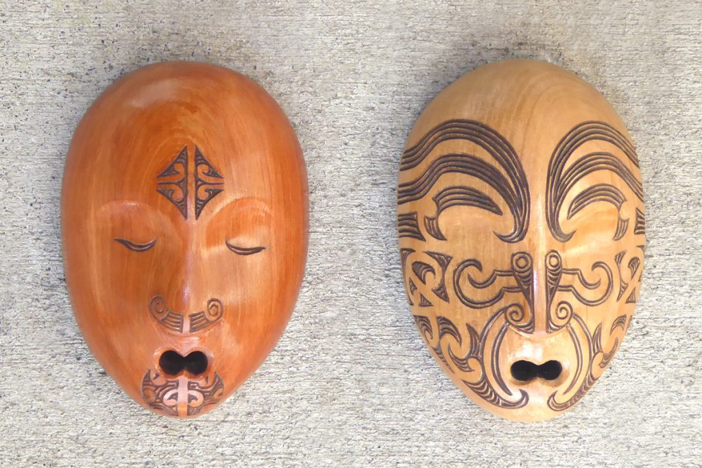 Carved wood masks with maori tattoo/moko by Thomas Hansen