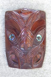 Carved wooden maori wheku by Thomas Hansen
