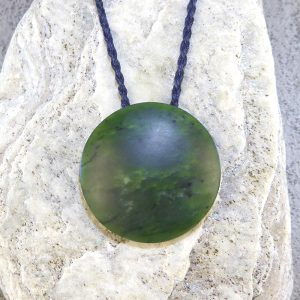 NZ greenstone kopae or disc pendant by Tim Steel