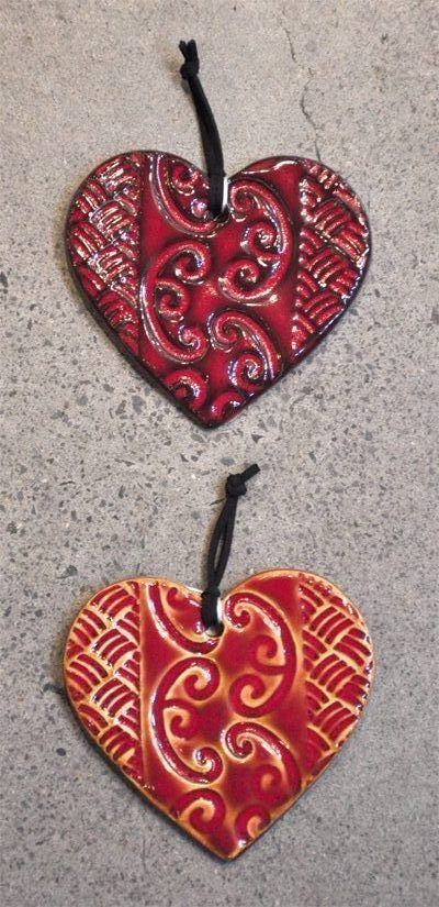 Small patterned red ceramic hearts by Michelle Bow